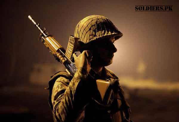 soldier with halmet and gun on shoulder