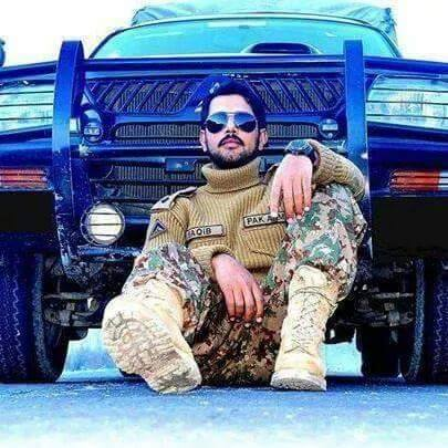 Officer Saqib sitting in front of Army mitshbishi